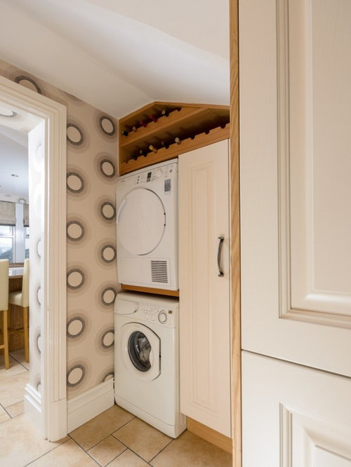 Elegant Laundry Closet Photo In Manchester With A Stacked Washer/dryer