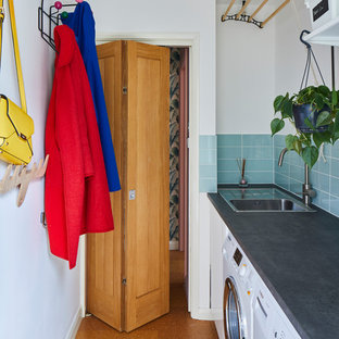 Midcentury single-wall dedicated laundry room in London with a drop-in sink, white walls, cork floors, a side-by-side washer and dryer and grey benchtop.