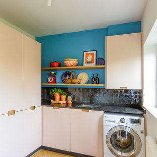 Photo of an eclectic utility room in Hertfordshire.