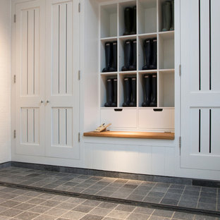 Photo of a modern utility room in Wiltshire with limestone flooring.