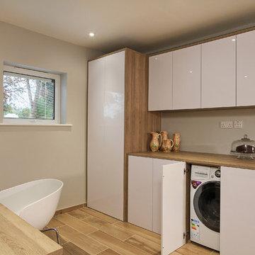 Rotpunkt Wood & High Gloss Kitchen in Bardolia & Zerox HL Icy White.