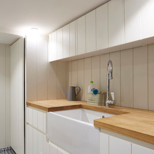 Laundry room - industrial laundry room idea in London
