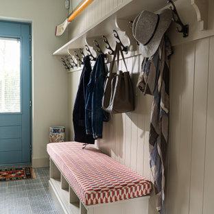 Inspiration för skandinaviska tvättstugor, med klinkergolv i porslin och blått golv