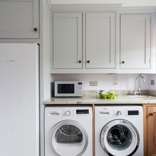 Example of a small classic single-wall laundry room design in Wiltshire with beaded inset cabinets, granite countertops, an undermount sink, gray cabinets and purple walls