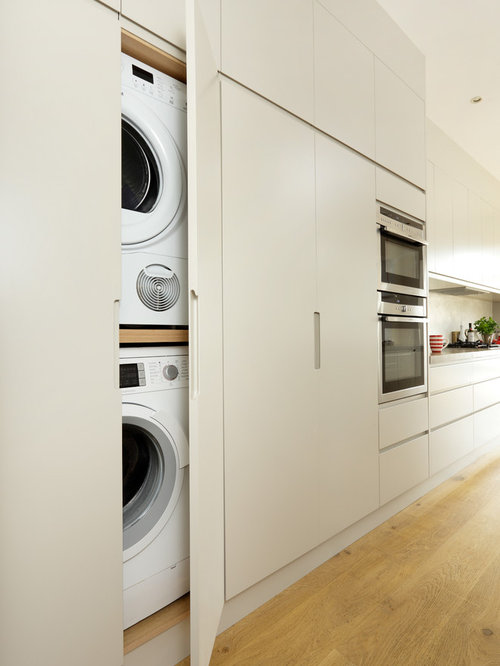 Hidden washing machine houzz for Kitchen cabinet washing machine