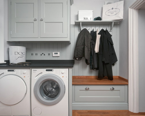 inspiration for a small timeless single wall utility room remodel in other with flat