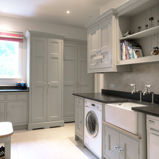 This is an example of an expansive traditional utility room in London.