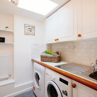Ornate laundry room photo in Cornwall