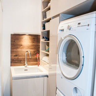 This is an example of a contemporary utility room in London.