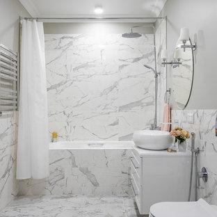 На фото: ванные комнаты в стиле современная классика с фасадами в стиле шейкер, белыми фасадами, душем над ванной, инсталляцией, серой плиткой, белой плиткой, серыми стенами, душевой кабиной, консольной раковиной, белым полом и белой столешницей