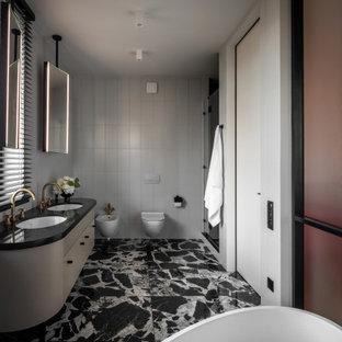 На фото: большая главная ванная комната в современном стиле с плоскими фасадами, серыми фасадами, душем в нише, инсталляцией, белой плиткой, белыми стенами, врезной раковиной, разноцветным полом, душем с распашными дверями и черной столешницей с