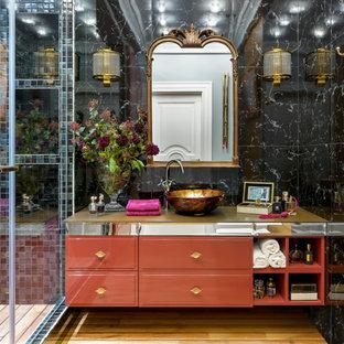 Пример оригинального дизайна: ванная комната в стиле современная классика с оранжевыми фасадами, черной плиткой, душевой кабиной, настольной раковиной, коричневым полом и желтой столешницей