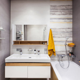 Mid-sized trendy master gray tile and porcelain tile porcelain floor and gray floor bathroom photo in Moscow with flat-panel cabinets, white cabinets and a trough sink