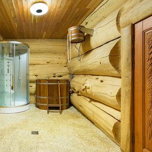 На фото: с высоким бюджетом большие главные ванные комнаты в стиле рустика с бежевыми фасадами, угловым душем, деревянным полом и бежевыми стенами