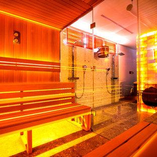 Пример оригинального дизайна интерьера: баня и сауна в современном стиле с двойным душем