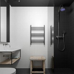 Idee per una stanza da bagno padronale design di medie dimensioni con doccia a filo pavimento, pistrelle in bianco e nero, piastrelle di ciottoli, pareti nere, pavimento con piastrelle a mosaico, lavabo da incasso e top in legno