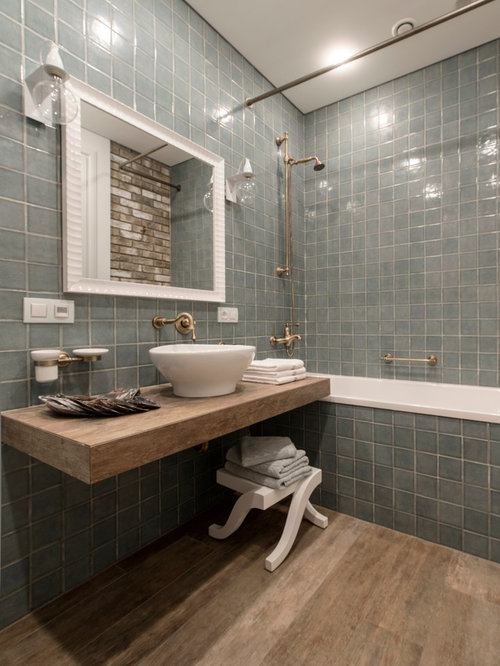 Bathroom design ideas renovations photos with blue tile for Bath remodel gurnee
