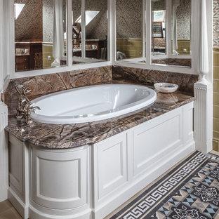 На фото: ванные комнаты в викторианском стиле с накладной ванной, бежевой плиткой, синей плиткой, коричневой плиткой и разноцветными стенами