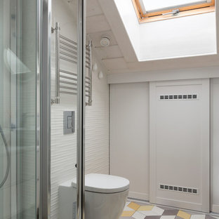 This is an example of a mid-sized scandinavian 3/4 bathroom in Moscow with a two-piece toilet, white tile and yellow floor.