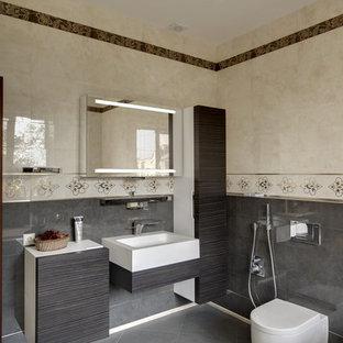 На фото: ванные комнаты в современном стиле с инсталляцией и монолитной раковиной