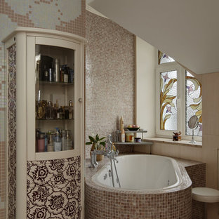 Photo of a medium sized classic ensuite bathroom in Moscow with a submerged bath, a corner shower, a two-piece toilet, pink tiles, mosaic tiles, pink walls, ceramic flooring, a vessel sink, pink floors and a sliding door.