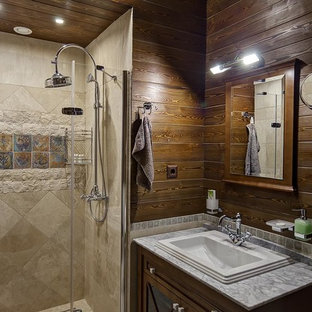 На фото: ванная комната в стиле кантри с коричневыми фасадами, душем в нише, коричневыми стенами, душевой кабиной, накладной раковиной, душем с распашными дверями и серой столешницей