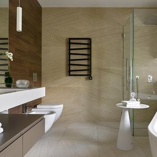 На фото: ванные комнаты в современном стиле с плоскими фасадами, коричневыми фасадами, отдельно стоящей ванной, угловым душем, биде, бежевой плиткой, монолитной раковиной, бежевым полом, душем с распашными дверями и белой столешницей