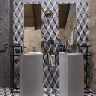 На фото: ванная комната в стиле лофт с серой плиткой, монолитной раковиной и серым полом