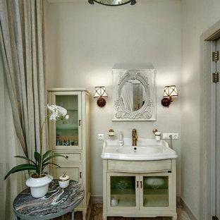 Foto di una stanza da bagno shabby-chic style con lavabo a consolle, ante di vetro, ante beige, piastrelle in pietra, pareti bianche e pavimento in marmo