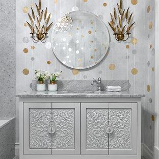 На фото: главная ванная комната в стиле современная классика с белыми фасадами, накладной ванной, серой плиткой, полом из мозаичной плитки, врезной раковиной, мраморной столешницей и серым полом с
