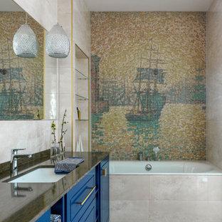 Идея дизайна: ванная комната в современном стиле с фасадами с выступающей филенкой, синими фасадами, накладной ванной, разноцветной плиткой, плиткой мозаикой, врезной раковиной, коричневым полом и коричневой столешницей