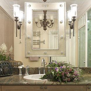 На фото: маленькая главная ванная комната в классическом стиле с фасадами с утопленной филенкой, искусственно-состаренными фасадами, зеленой плиткой, цементной плиткой, бежевыми стенами, полом из керамогранита, накладной раковиной и мраморной столешницей с