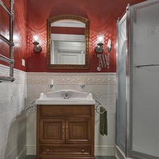 Cette photo montre une salle d'eau chic avec des portes de placard en bois brun, un carrelage blanc, des carreaux de céramique, un mur rouge, un sol en carrelage de céramique, un placard avec porte à panneau encastré, une douche d'angle et un plan vasque.