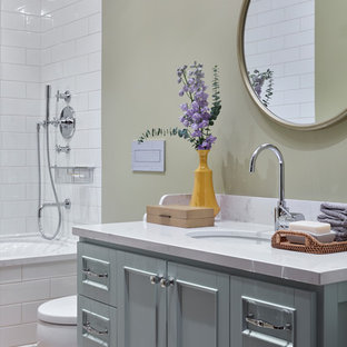 Design ideas for a mid-sized transitional bathroom in Moscow with turquoise cabinets, a shower/bathtub combo, a two-piece toilet, white tile, ceramic tile, cement tiles, engineered quartz benchtops, yellow floor, a shower curtain, recessed-panel cabinets, an alcove tub, beige walls and an undermount sink.