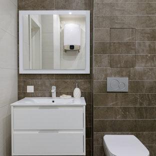 Свежая идея для дизайна: ванная комната среднего размера в современном стиле с плоскими фасадами, белыми фасадами, серой плиткой, керамогранитной плиткой, полом из керамогранита, душевой кабиной, монолитной раковиной, серым полом и белой столешницей - отличное фото интерьера