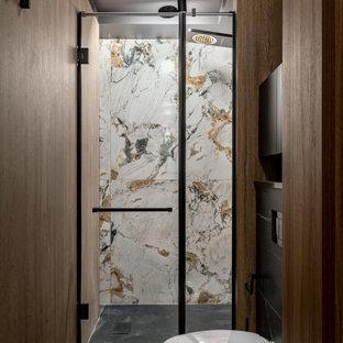 На фото: маленькая ванная комната в стиле современная классика с стеклянными фасадами, черными фасадами, душем в нише, инсталляцией, коричневой плиткой, керамогранитной плиткой, коричневыми стенами, полом из керамогранита, душевой кабиной, подвесной раковиной, стеклянной столешницей, черным полом, душем с распашными дверями, черной столешницей, унитазом, тумбой под одну раковину, подвесной тумбой и панелями на стенах