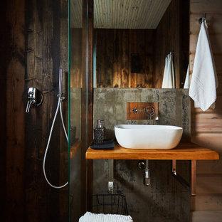 На фото: ванная комната среднего размера в стиле рустика с угловым душем, коричневыми стенами, душевой кабиной, подвесной раковиной, столешницей из дерева, коричневой столешницей, тумбой под одну раковину, подвесной тумбой и деревянными стенами