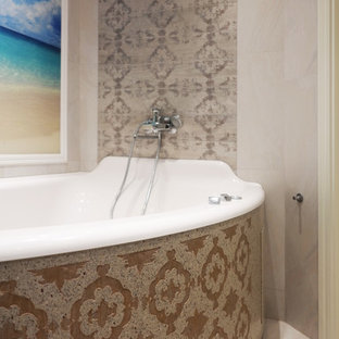 Tub/shower combo - mid-sized eclectic master beige tile and porcelain tile ceramic floor tub/shower combo idea in Moscow with flat-panel cabinets, beige cabinets, a hot tub, a wall-mount toilet, gray walls, a vessel sink and solid surface countertops