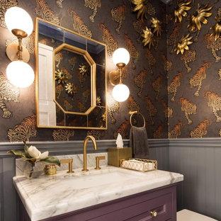 На фото: ванная комната в современном стиле с фасадами с утопленной филенкой, фиолетовыми фасадами, врезной раковиной, белой столешницей и коричневыми стенами с