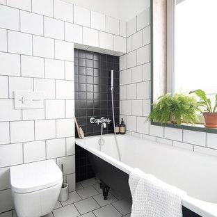 Идея дизайна: маленькая главная ванная комната в стиле лофт с ванной на ножках, душем над ванной, инсталляцией, белой плиткой, керамической плиткой, белыми стенами, полом из керамической плитки и белым полом