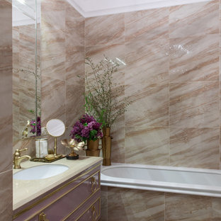 Design ideas for a transitional bathroom in Other with purple cabinets, an undermount tub, beige tile, an undermount sink and multi-coloured floor.