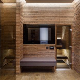 Удачное сочетание для дизайна помещения: большая баня и сауна в современном стиле с керамогранитной плиткой, полом из керамогранита и коричневой плиткой - самое интересное для вас