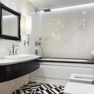 Идея дизайна: главная ванная комната в современном стиле с темными деревянными фасадами, полновстраиваемой ванной, биде, белой плиткой, накладной раковиной и разноцветным полом