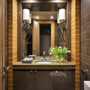 На фото: ванные комнаты в современном стиле с плоскими фасадами, коричневыми фасадами, душем в нише, раздельным унитазом, коричневой плиткой, душевой кабиной и врезной раковиной
