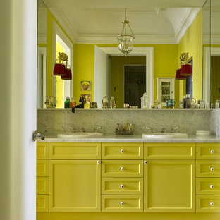 Example of an eclectic master ceramic floor bathroom design in Moscow with recessed-panel cabinets, yellow cabinets, yellow walls and a drop-in sink