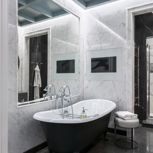 Example of a large eclectic master marble tile gray floor claw-foot bathtub design in Moscow