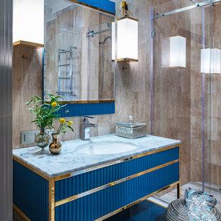 На фото: ванная комната в современном стиле с синими фасадами, душевой кабиной, врезной раковиной, душем с раздвижными дверями, серой столешницей, фасадами островного типа, душем в нише, коричневой плиткой и коричневыми стенами с