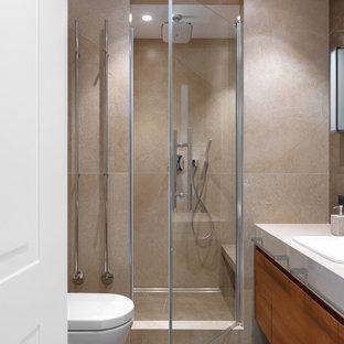 На фото: ванная комната среднего размера в современном стиле с плоскими фасадами, темными деревянными фасадами, бежевой плиткой, керамогранитной плиткой, полом из керамогранита, душевой кабиной, столешницей из плитки, душем с распашными дверями, бежевой столешницей, душем в нише, накладной раковиной и бежевым полом