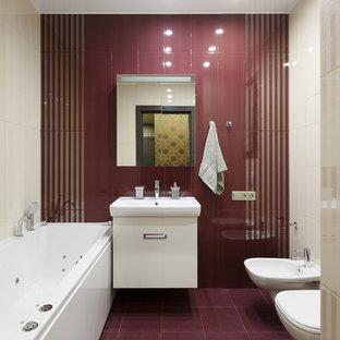 На фото: со средним бюджетом главные ванные комнаты среднего размера в современном стиле с плоскими фасадами, белыми фасадами, гидромассажной ванной, биде, белой плиткой, красной плиткой и монолитной раковиной