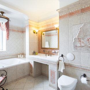 Выдающиеся фото от архитекторов и дизайнеров интерьера: главная ванная комната в средиземноморском стиле с гидромассажной ванной, инсталляцией, серой плиткой и монолитной раковиной